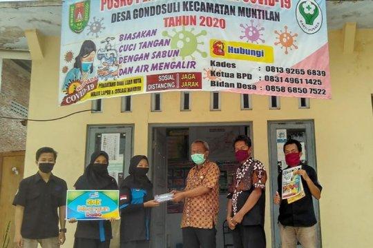 """Lewat Program """"Mbangun Desa"""", siswa di Magelang bagikan ribuan masker"""