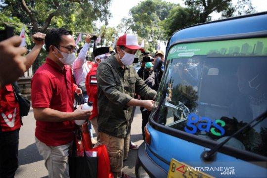 PKPI bagikan 200 paket sembako kepada sopir bajaj di Jakarta