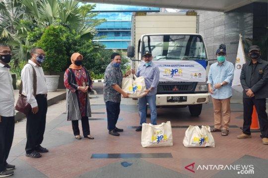 Kementerian PUPR salurkan paket sembako bersama PWI Pusat