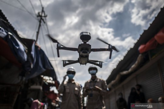 Pengukuran suhu tubuh mengunakan drone