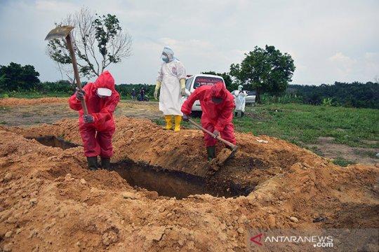 Era normal baru untuk penggali kuburan COVID-19
