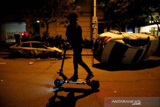 Aksi unjuk rasa berlanjut, jam malam di negara bagian AS diperpanjang