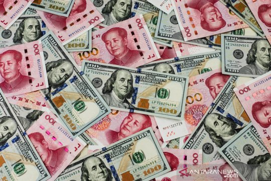 Yuan terus melemah, turun 30 basis poin jadi 7,0903 terhadap dolar AS