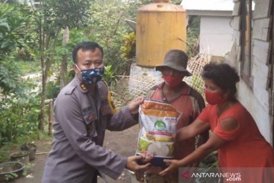 Polres Minahasa Tenggara bantu bahan pangan warga transmigrasi