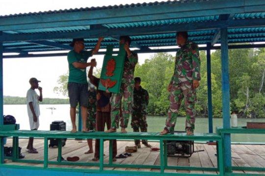 Prajurit TNI Yonif 754/ENK bangun dermaga serba guna di Bonggo Sarmi