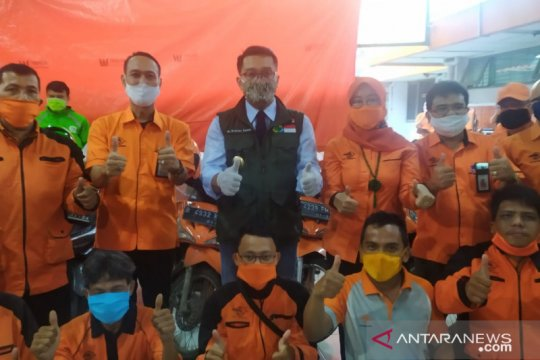 Merawat sinergi melalui penyaluran bansos kelompok terdampak