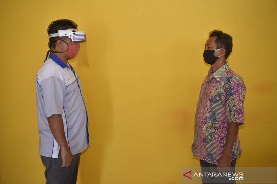 Inovasi alat pelindung wajah dengan sensor jarak