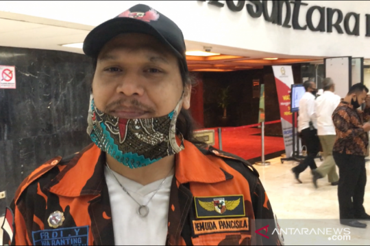 Pedemo RUU HIP berbaju loreng oren buat anggota DPR terkesan