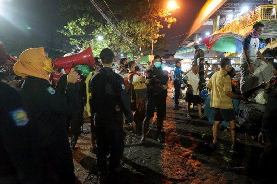 Operasi pakai masker sasar wilayah pemukiman di Surabaya