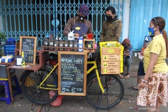 Pemanfaatan sepeda kayuh sebagai kafe mini