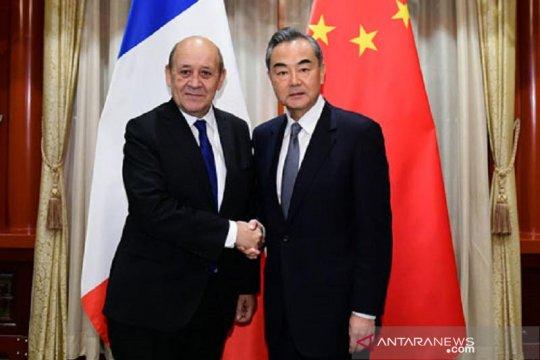 Kepada Menlu Prancis, Wang Yi nyatakan siap bersikap tegas terhadap AS