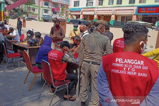 Langgar protokol kesehatan, puluhan warga Pekanbaru jalani hukuman