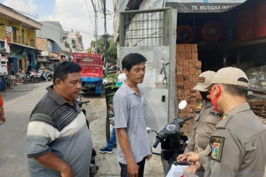 Operasi tertib masker di Jalan Ancol Selatan jaring 21 warga