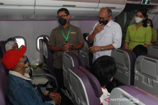 Kampanye aman berwisata dengan pesawat
