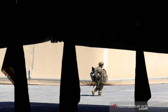 Penyerahan pangkalan pasukan koalisi pimpinan AS kepada Irak