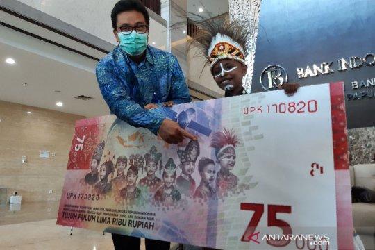 Ini dia bocah laki-laki Papua di pecahan uang Rp75 ribu