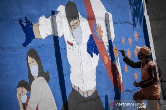 Mural waspada virus Corona
