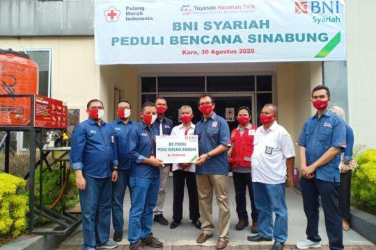 BNI Syariah Medan bantu sembako untuk warga terdampak erupsi Sinabung