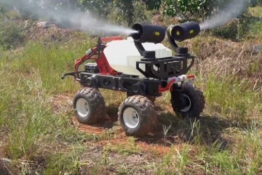 Kendaraan nirawak digunakan sebagai penyemprot pestisida di Hunan, China