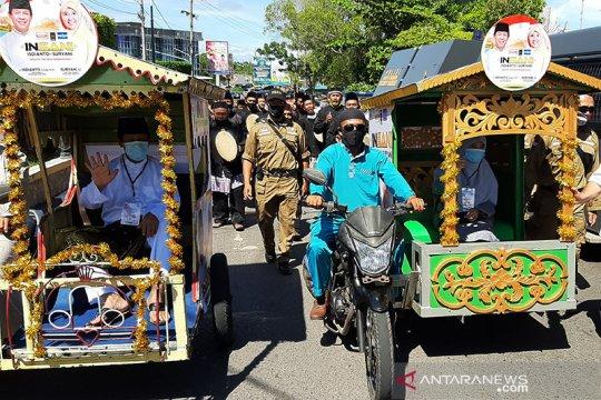 Isdianto-Suryani naik becak motor daftar Pilgub Kepri ke KPU