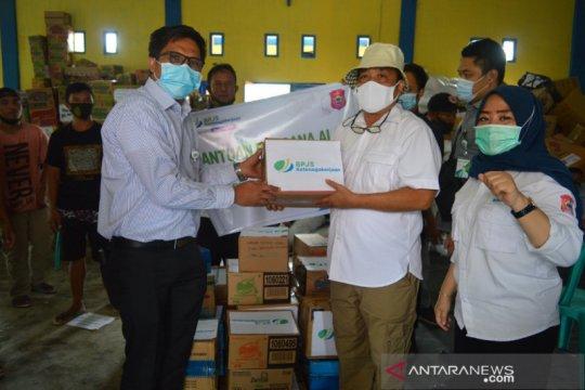 BPJamsostek Gorontalo salurkan bantuan korban bencana Bulawa