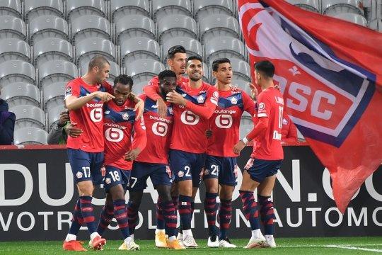 Lille cukur sembilan pemain Lens untuk ambil alih puncak klasemen