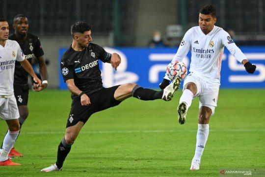Real bangkit dari tertinggal dua gol untuk imbang 2-2 dengan Gladbach