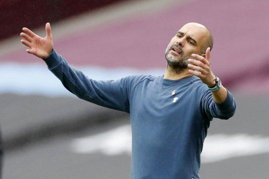 Tepis rumor Barca, Guardiola tegaskan ingin lebih lama di Man City