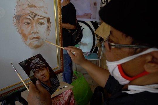 Belasan seniman Solo lukis wajah Gibran untuk dilelang