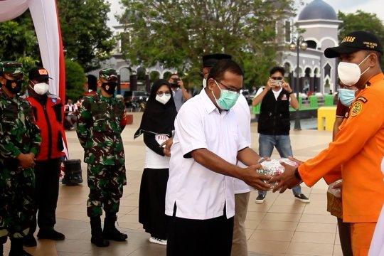Kemenko PMK salurkan bantuan masker kepada Satgas COVID-19 Malut
