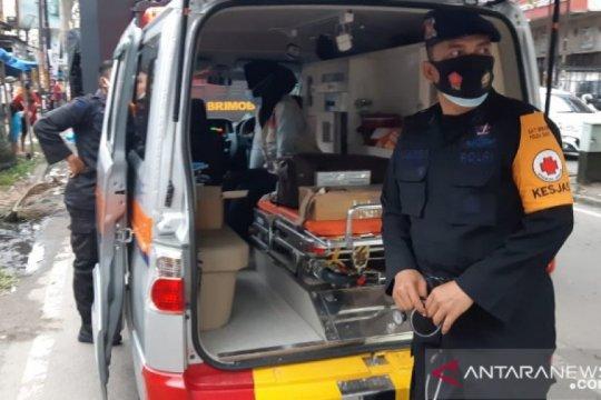 Brimob Polda Sumut obati korban banjir di Medan