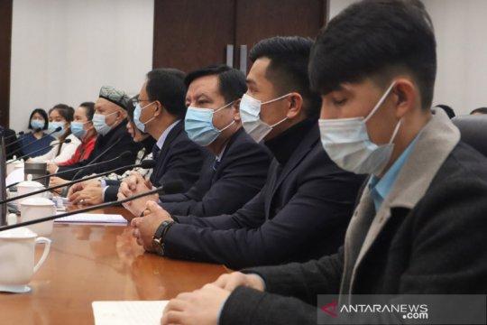 Tokoh Uighur dan  lulusan kamp Xinjiang temui media asing di Beijing