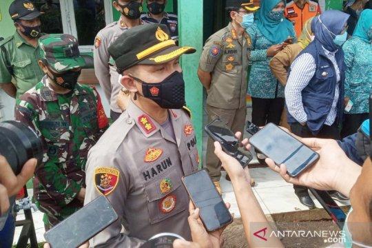 Polres Bogor tetapkan dua tersangka pembuang sampah APD