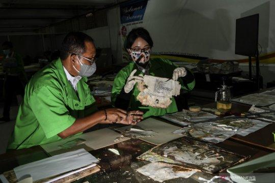 Restorasi arsip korban banjir