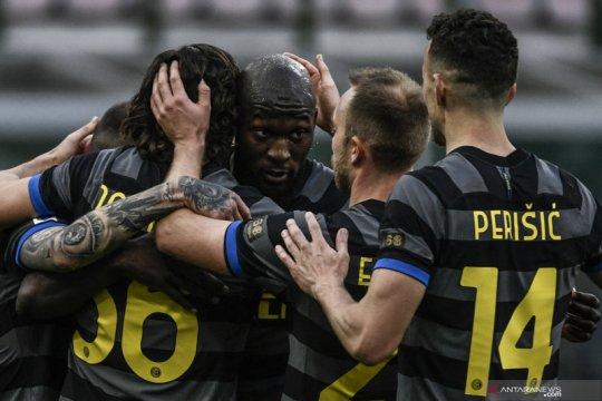 Inter tundukkan Genoa 3-0 untuk unggul tujuh poin atas Milan