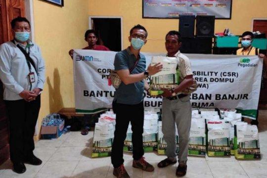 Pegadaian salurkan bantuan pangan untuk korban banjir di NTB-NTT