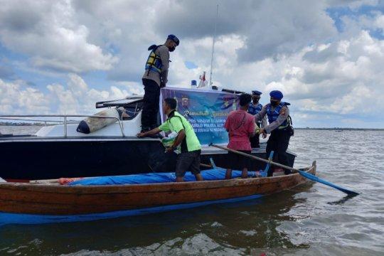 Polisi Kepulauan Meranti patroli di laut ingatkan bahaya COVID-19