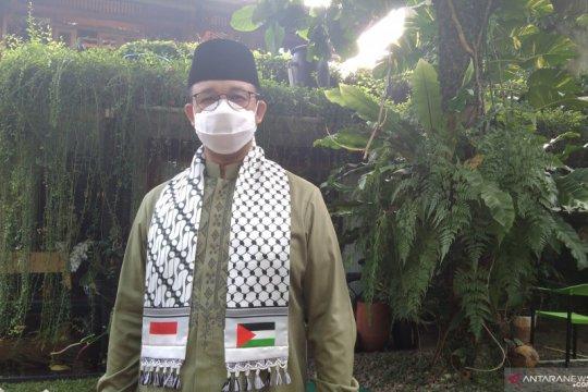 Anies Shalat Id gunakan sorban berbendera Palestina