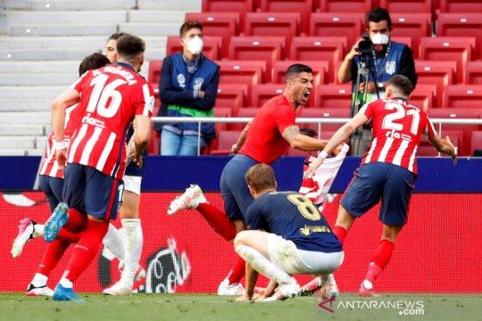 Menang dramatis atas Osasuna, Atletico Madrid tetap puncaki klasemen