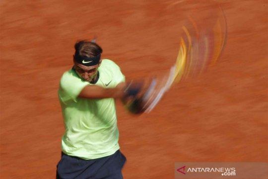 Nadal menuju semifinal ke-14 di tanah liat Roland Garros
