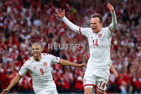 Babak pertama, Denmark unggul 1-0, Belgia vs Finlandia 0-0