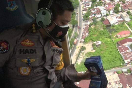 Polda Sumut sebar ribuan brosur PPKM Darurat melalui helikopter