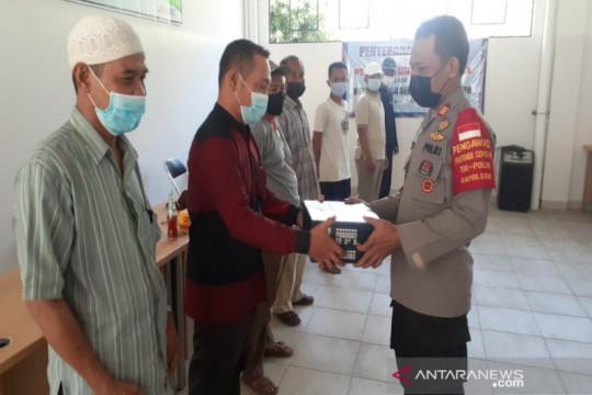 Polres Pekalongan Kota-PT Pajitek bagikan paket sembako