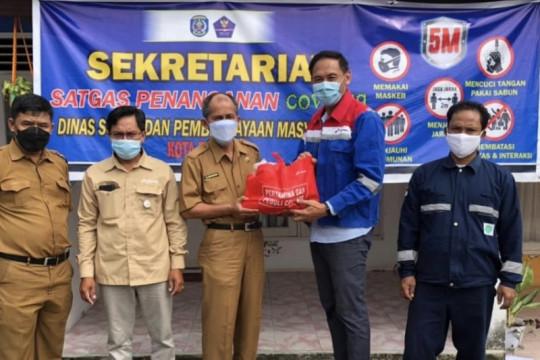 Pertagas serahkan bantuan bagi warga isoman dan nakes di Bontang