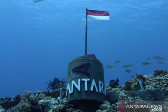 Angin kencang tak surutkan pemasangan Tugu ANTARA di dasar laut Natuna