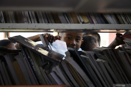 Mendorong literasi budaya baca melalui digitalisasi perpustakaan