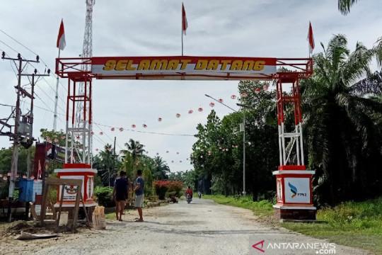 Satgas TNI bersama warga perbatasan bangun Gapura Merah Putih