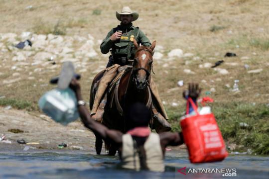 "Gedung Putih kritik ancaman ""pecut"" pada imigran Haiti"