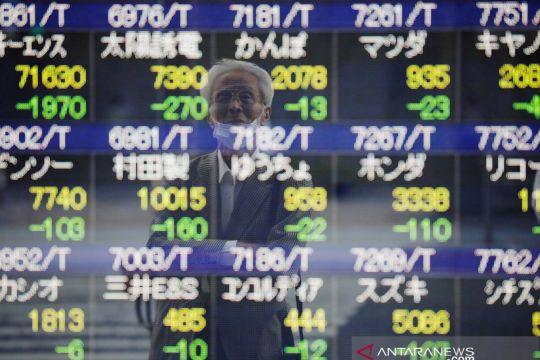Saham Jepang naik-turun ketika investor menunggu data inflasi AS