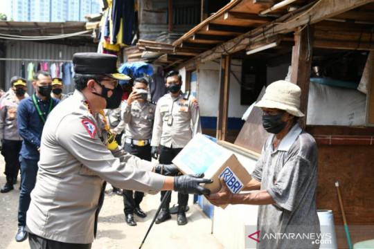 Korlantas Polri gandeng HMI salurkan 1.000 paket sembako buat pemulung